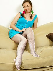 Smiling teen beaut seduces her boyfriend with her patterned nylons